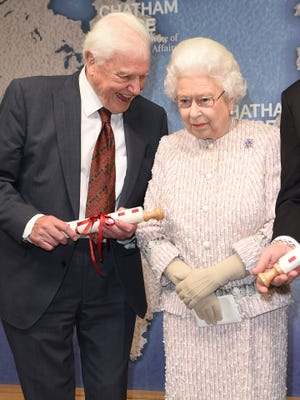 Queen Elizabeth II with Sir David Attenborough after she presented him with the 2019 Chatham House Prize at the Royal institute of International Affairs in London on Nov. 20, 2019.