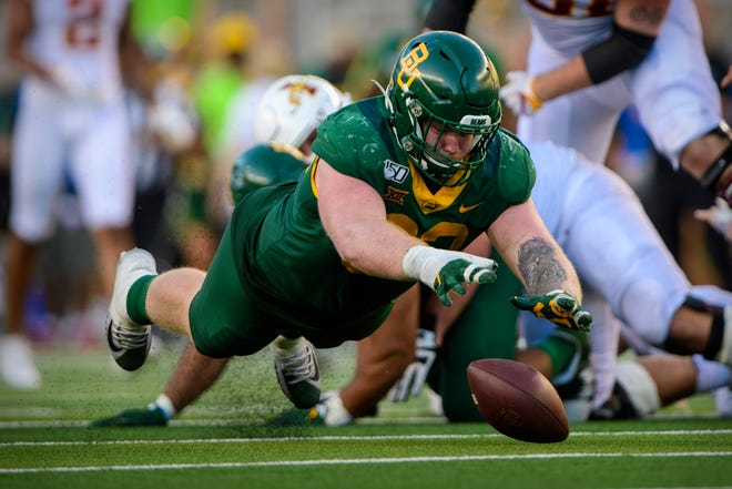 Baylor Bears defensive tackle James Lynch recovers a fumble by Iowa State Cyclones quarterback Brock Purdy earlier this season.