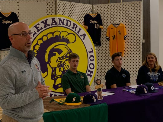 Alexandria Senior High coach Greg Briggs (left) talks about pitchers Cy Fontenot (second left) and Tyler Pope (second right) during their signing day Wednesday.