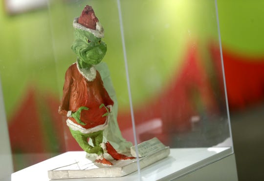 A one-of-a-kind Grinch maquette stands on display at the Trout Museum of Art in Appleton.