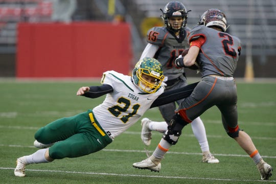 Edgar's Kaleb Hafferman (21) tries to tackle Jaylen Rufenacht (2) of Black Hawk/Warren (Ill.) during Thursday's WIAA Division 7 state championship game at Camp Randall Stadium in Madison.