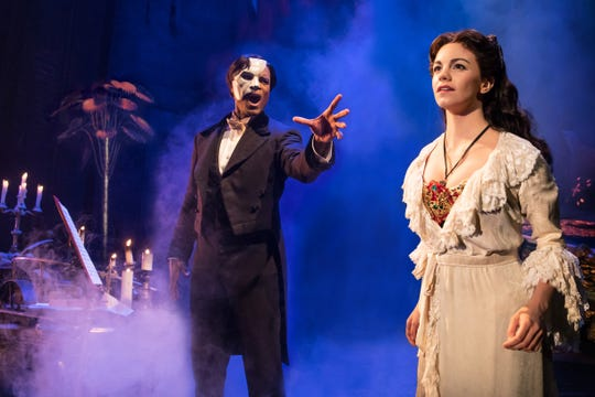 "Derrick Davis, left, and Emma Grimsley in ""The Phantom of the Opera."""