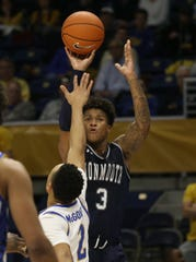 Monmouth Hawks guard Deion Hammond (3) shoots over Pittsburgh Panthers guard Trey McGowens (2) during the second half  at the Petersen Events Center.