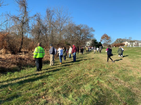 Volunteers gather Thursday, Nov. 21, 2019, to search for Stephanie Parze in a wooded area near her Freehold Township house. She has been missing since Oct. 30.