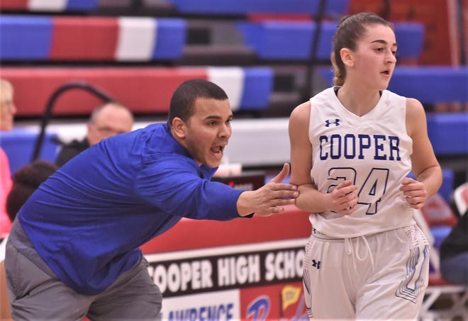 Cooper coach Arsenio Geter, left, accidentally touches Meri Tetaj as she runs up court while trying to get his players to run an offense during the second half against El Paso Franklin. Cooper won 47-33 in the opening game of the Polk-Key City Classic on Thursday, Nov. 21, 2019, at Cougar Gym.
