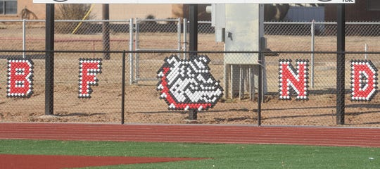 "A fence decoration reminds visitors at Coahoma's Bill Easterling Memorial Stadium that ""Bulldog fight never dies."""