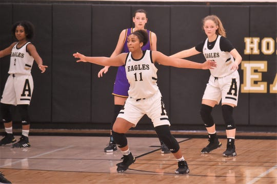 Abilene High's Destiny Potts (11) gives the Lady Eagles versatility as an undersized forward. Potts finished with 13 points against Sanger in the opening round of the Polk-Key City Classic at Eagle Gym on Thursday, Nov. 21, 2019.
