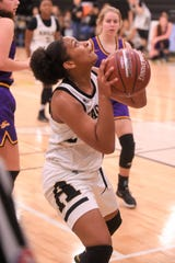 Abilene High forward Destiny Potts (11) goes up for a shot against Sanger in the opening round of the Polk-Key City Classic at Eagle Gym on Thursday, Nov. 21, 2019. Potts finished with 13 points in the 50-37 setback.