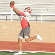 Coahoma receiver Tony Hagins makes a catch during practice Tuesday.