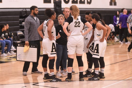 Abilene High head coach Terri Aston gives instructions to Destiny Potts (11) during a timeout against Sanger in the opening round of the Polk-Key City Classic at Eagle Gym on Thursday, Nov. 21, 2019. Potts finished with 13 points in the 50-37 setback.