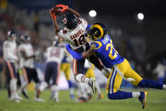 Los Angeles Rams cornerback Jalen Ramsey breaks up a pass intended for Chicago Bears wide receiver Taylor Gabriel, left, during the first half Sunday, Nov. 17, 2019, in Los Angeles.