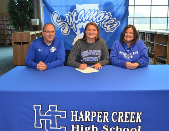 Harper Creek standout Maddie Alexander has signed to play soccer at Indiana State, joined by her parents Alton and Jennifer Alexander.