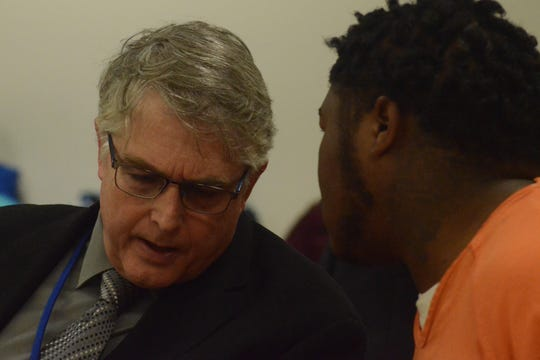 Defense attorney Donald Hammond confers with Xavier Kellie-Sims.