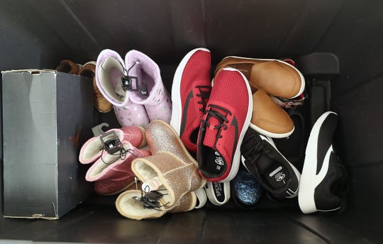 "Ridgetop Middle School's ""New Shoes for Cool Kids"" donations fill the bin in the hallway at the school."