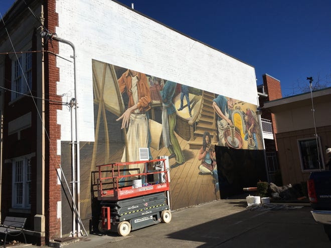 A mural by Scott Allred and Jeremy Russell of Brushcan Custom Murals and Design is installed on the western wall of the Black Mountain Center for the Arts.