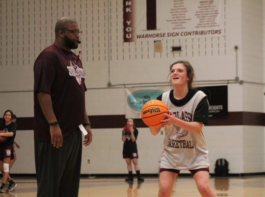 First-year Warlassies head coach Anderson Bynum distracts freshman Carly Hancock at the free throw line during practice, as Owen prepared to open its season on the road against Thomas Jefferson Classical Academy.