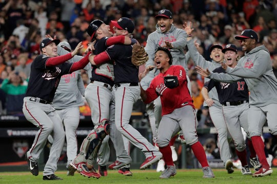 The Washington Nationals celebrate after Game 7 of the World Series against the Houston Astros on Oct. 30, 2019, in Houston. The Nationals won 6-2 to win the series.