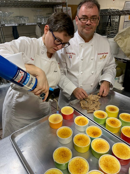 Jackie Dittmore and Christophe Molitor caramelize the tops of creme brulee with raw cane sugar.