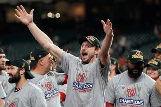 Washington Nationals starting pitcher Max Scherzer celebrates after Game 7 of the World Series against the Houston Astros on Oct. 30, 2019, in Houston. The Nationals won 6-2 to win the series.  Scherzer needed a cortisone injection after experiencing neck spasms.