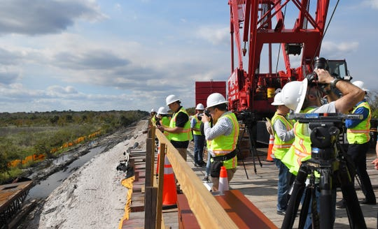 A temporary trestle bridge built in order to then build a railroad bridge along State Road 528 over Taylor Creek.There will be eventually be a total of 55 bridges in the Phase 2 extension for Virgin Trains from Orlando to West Palm Beach. Scenes from the Virgin Trains Orlando extension and behind-the-scenes bus tour of construction going on from Orlando to Cocoa.