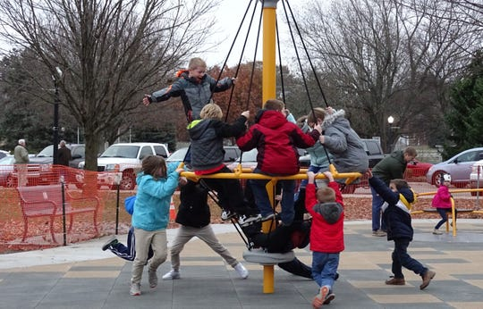 Children enjoy the new playground at Galion's Heise Park after a ribbon-cutting ceremony on Wednesday.