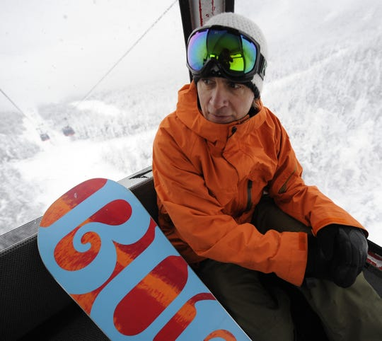 Jake Burton , founder of Burton Snowboards, in the gondola at Stowe Mountain Resort in 2010.