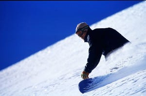 Jake Burton Carpenter snowboards in this file photo from 1998.
