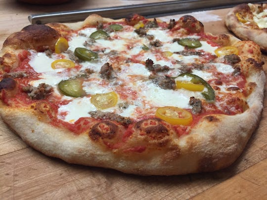 The Leah pizza at Barrio in Burlington is topped with Italian sausage and pickled jalapeno peppers.