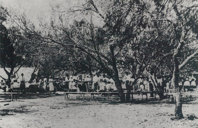 This undated contributed photo shows the early years of the annual Thankgiving feasts hosted by Our Lady of Consolation in Vattman, Texas. The first was held in 1913 and was an outdoor picnic for years before it moved indoors.