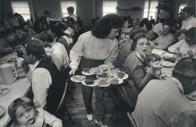Yvonne Yaklin of Riviera serves us dessert in the Our Lady of Consolation parish hall in Vattman, Texas on Nov. 26, 1987. The parish has hosted a Thanksgiving feast since 1913.