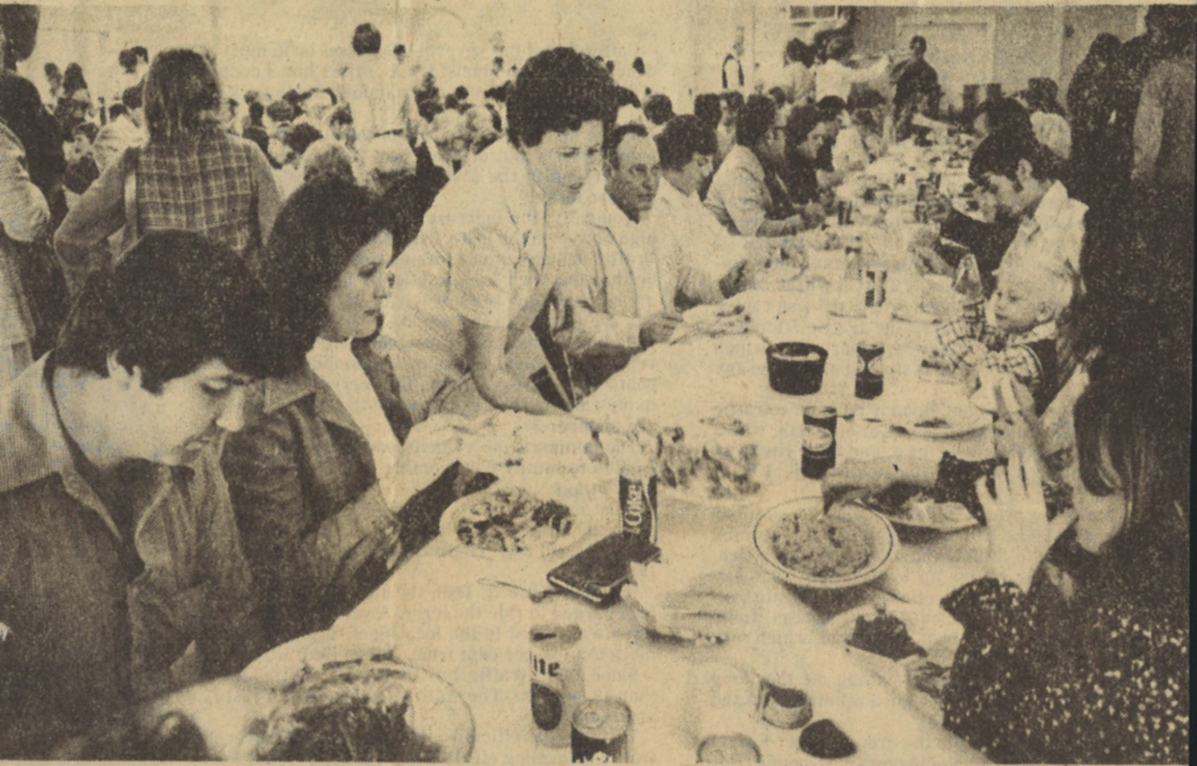 People gather for good food and togetherness at Our Lady of Consolation parish hall in Vattman, Texas on Nov. 27, 1975.