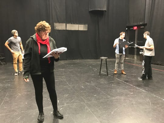 Susan Dewey, an actor from Cherry Hill, reflects on the script for 'The Walk,' a one-act play based on Howard Unruh's 1949 shooting spree in Camden. Dewey plays Unruh's mother, Freda, in the production.