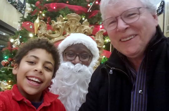 David Lyman, right, with his son, Oliver, and Santa.