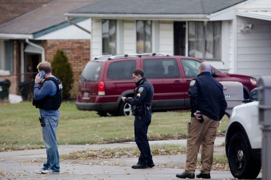 Police gather information on the scene of a shooting on Newmarket Drive, a block from Northwest High School in Colerain Township on Thursday, Nov. 21, 2019.