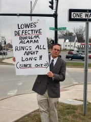 Colerain Township resident Jim Delp picketed outside the Lowe's Home Improvement store Nov. 17 after he said efforts to stop a malfunctioning alarm at the store from going off every evening since Oct. 27 were unsuccessful.