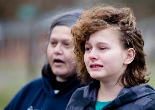 April Baker, 14, tears up while waiting to go outside police tape to go home near Northwest High School in Colerain Township on Thursday, Nov. 21, 2019. Baker said she witnessed a fatal shooting while walking home from the high school.