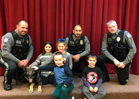On Thursday, Nov. 14, Kindergarten and first grade students were greeted by the Readington Township Police Department.   Chief Joseph Greco, Sgt. Carlos Ferreiro, and Officer Brian introduced K9 Polis to the students.  Students learned about K9 Polis' responsibilities as a member of the Readington Township Police Department. They even got to watch Ferreiro and K9 Polis in action. Pictured are Ferreiro, Greco, Brian, K9 Polis, Jordyn Correia, Abigail Manko, Declan Smith and Madden Champion.
