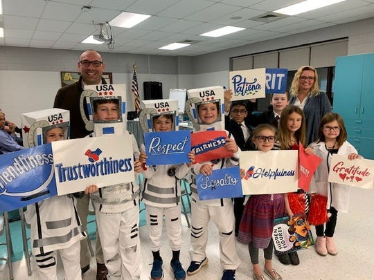 Whitehouse School Principal, Dr. Ann DeRosa; Paul Smith, school counselor; Emily Bengels, intervention teacher and student representatives attended the Wednesday, Nov. 13, board meeting. The students performed a skit on the 50th Anniversary of the Moon Landing which is Whitehouse School's thematic unit for the 2019-2020 school year. (Left to right) Dr. Jonathan Hart, superintendent; Colin Hirschorn, Joaquim Szalkowski, Lucas Dalfonzo, Robert Rosell, Shravan Patel, Finnegan Fosbre, Laura Simon, board president; Katherine Albrecht-Smith, Alexandra Burgey, and Samantha DiStefano.