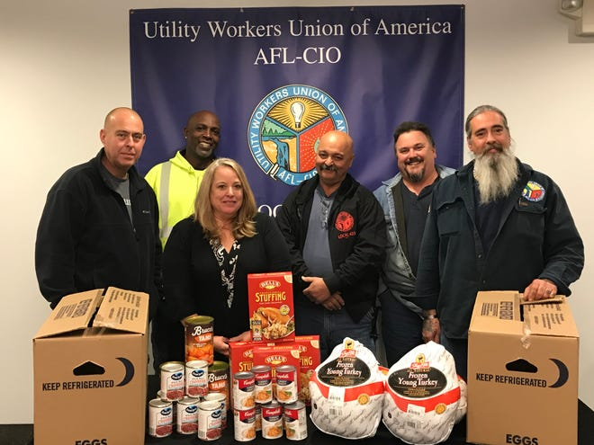 Members of Local 423 Utility Workers (left to right) Pat Mann, Kevin Bennett, Debbie Zwolinski, John Cuccaro, Craig Bolton and Mike Esposito converged at the union hall in Somerville to pack boxes filled with turkeys, boxed stuffing, and canned sweet potatoes, gravy and cranberry sauce that they will deliver — along with a $750 check — to the Food Bank Network of Somerset County in Bridgewater to help the facility put a traditional Thanksgiving dinner on the table of the 1,400 families that go there monthly for assistance.
