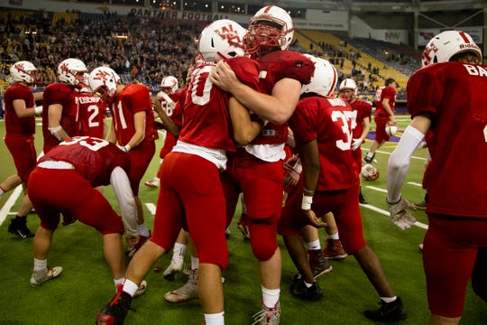 West Hancock celebrates it's 21-17 win over Grundy Center to win the Class A state football championship game at the UNI Dome on Thursday, Nov. 21, 2019, in Cedar Falls.