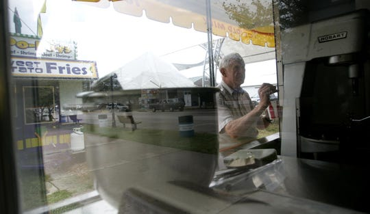 Joe Barksdale, of Des Moines' north side, gets his chocolate chip cookie trailer ready ahead of the 2009 Iowa State Fair.