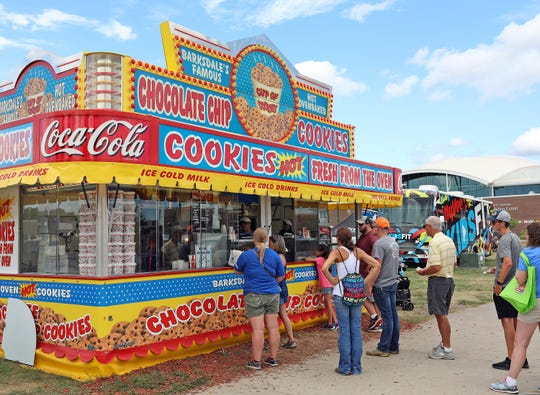 Hungry customers stop by the Barksdale's Famous Cup of Cookies stand on Grand Avenue on Aug. 17, 2019, at the Iowa State Fair.