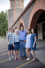 The Schroeder family poses for a photograph in August 2018, soon after state Rep. Andrea Schroeder's cancer diagnosis. From left are Luke, Andrea, Mark, Grace and Maggie Schroeder.