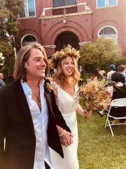 Scott and Marci Holmes Dalmbacher, a Port Huron couple who got married in Detroit in June. They received marijuana infused chocolate chip cookies as a wedding gift and decided to ask their guests if they wanted to share.