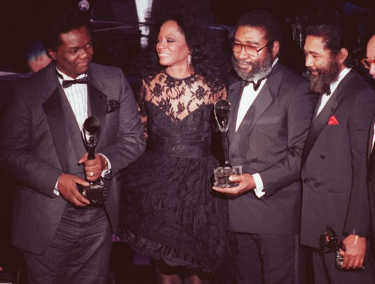 Diana Ross joins songwriters Lamont Dozier, left, Brian Holland, second from right, and Eddie Holland after the writing team was inducted into the Rock and Roll Hall of Fame Jan. 19, 1990 in New York City.