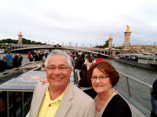 Bill and Patti Barker, of Clarkston, visited Paris in 2018. The couple hopes to travel more if Bill opts to retire before March 1 from his job at General Motors.