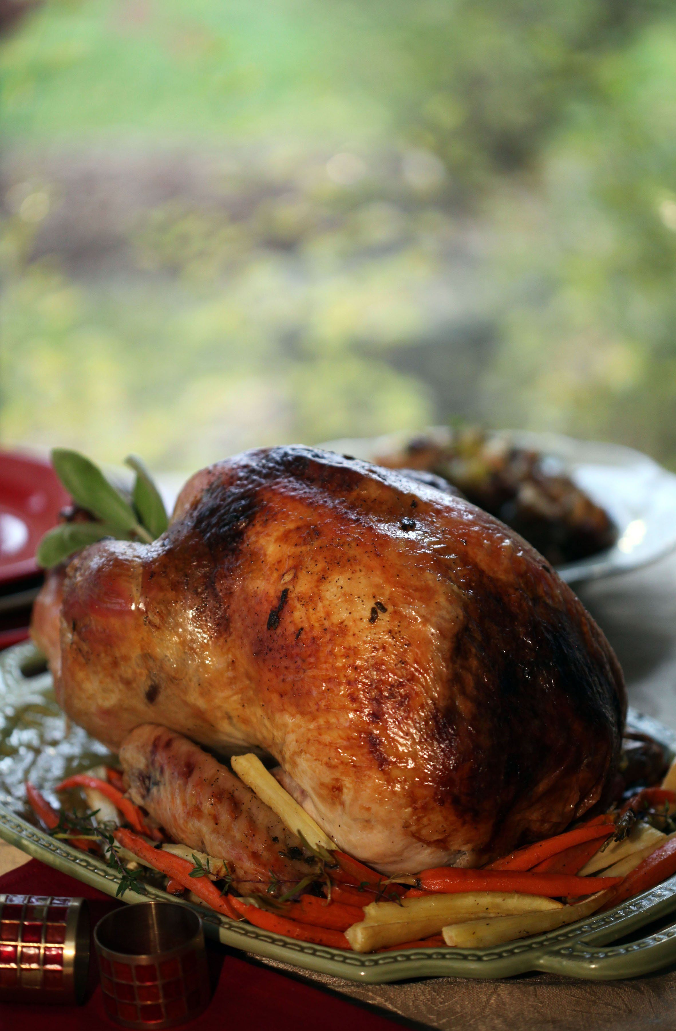 Honey brown, crisp skin with meat that's tender and juicy. That's a cook's goal for the holiday bird. Pictured is orange brined roast turkey with pan gravy. (Jessica J. Trevino/Detroit Free Press/MCT)