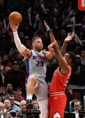 Detroit Pistons forward Blake Griffin (23) shoots over Chicago Bulls center Wendell Carter Jr. (34) during the first half  at United Center on Wednesday, Nov. 20, 2019, in Chicago.