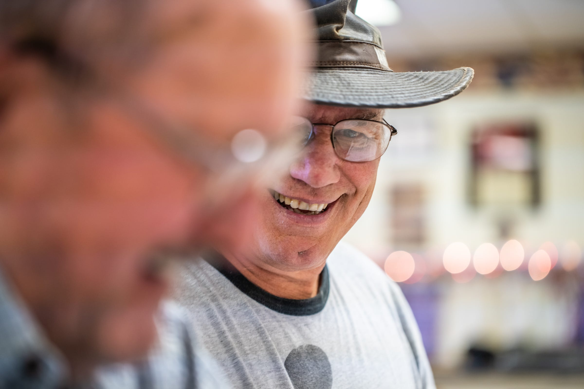 """VFW Post 4573 member Dennis Tonge (background), talks with others during a meeting at the hall in Ishpeming in Michigan's Upper Peninsula on Thursday, May 9, 2019.""""The biggest thing we got to start working on is how to draw the younger veterans in,"""" said Tonge, 66. He was soon taking over as commander."""