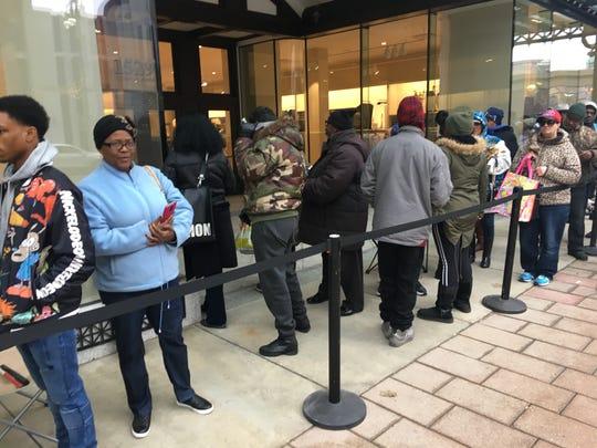 Michelle Jackson of Detroit (blue coat) waits in line for the Detroit H&M to open.